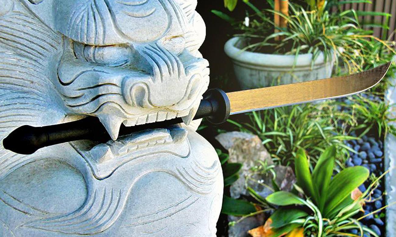 Kamienny lew lub tygrys z maczetą Cold Steel Thai