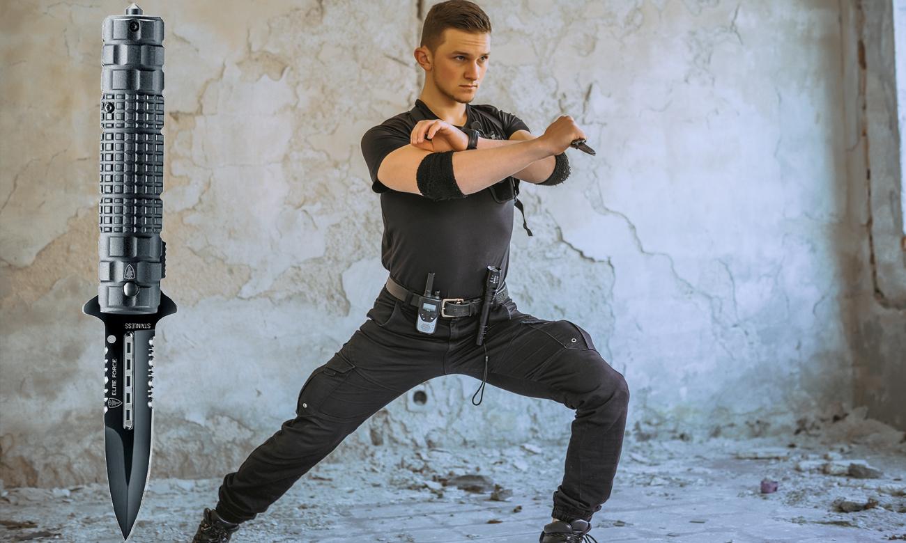 Mężczyzna z nożem składanym Elite Force EF104